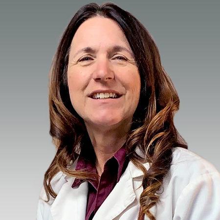 Brenda Phillips in white coat smiling
